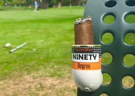 Cigar inside holder attached to golf cart
