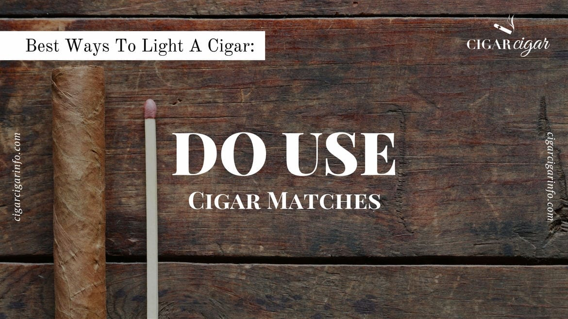 Cigar and match on wooden table