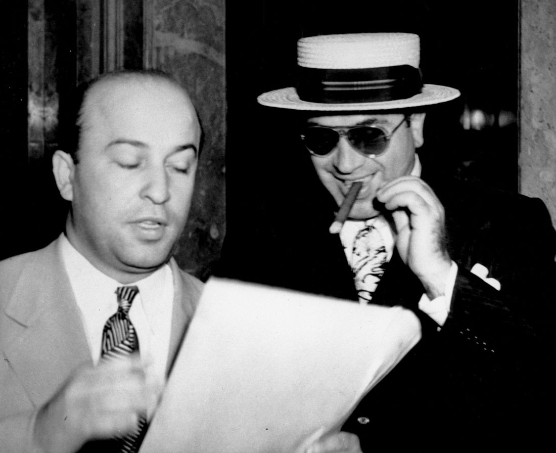 Al Capone smiling with a cigar
