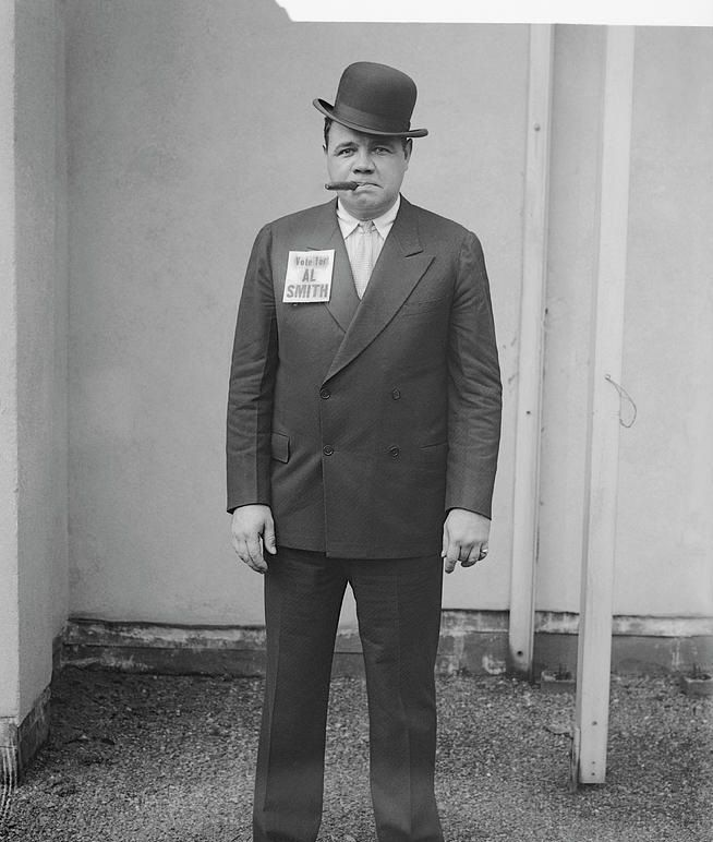 Babe ruth in a suit with stogie