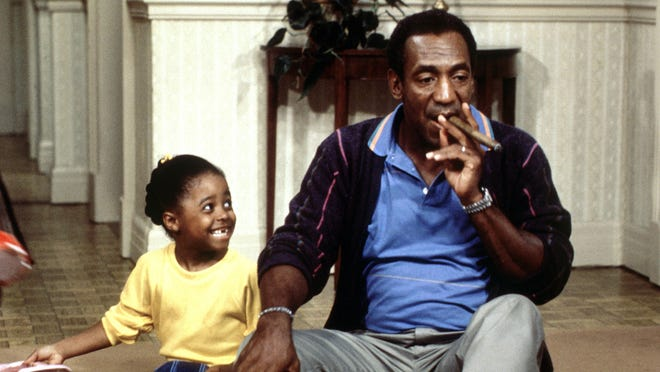 Bill Cosby smoking cigar