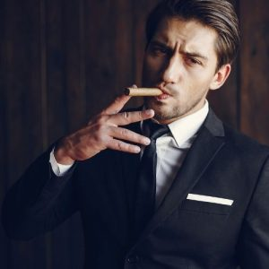 classy man smoking a cigar